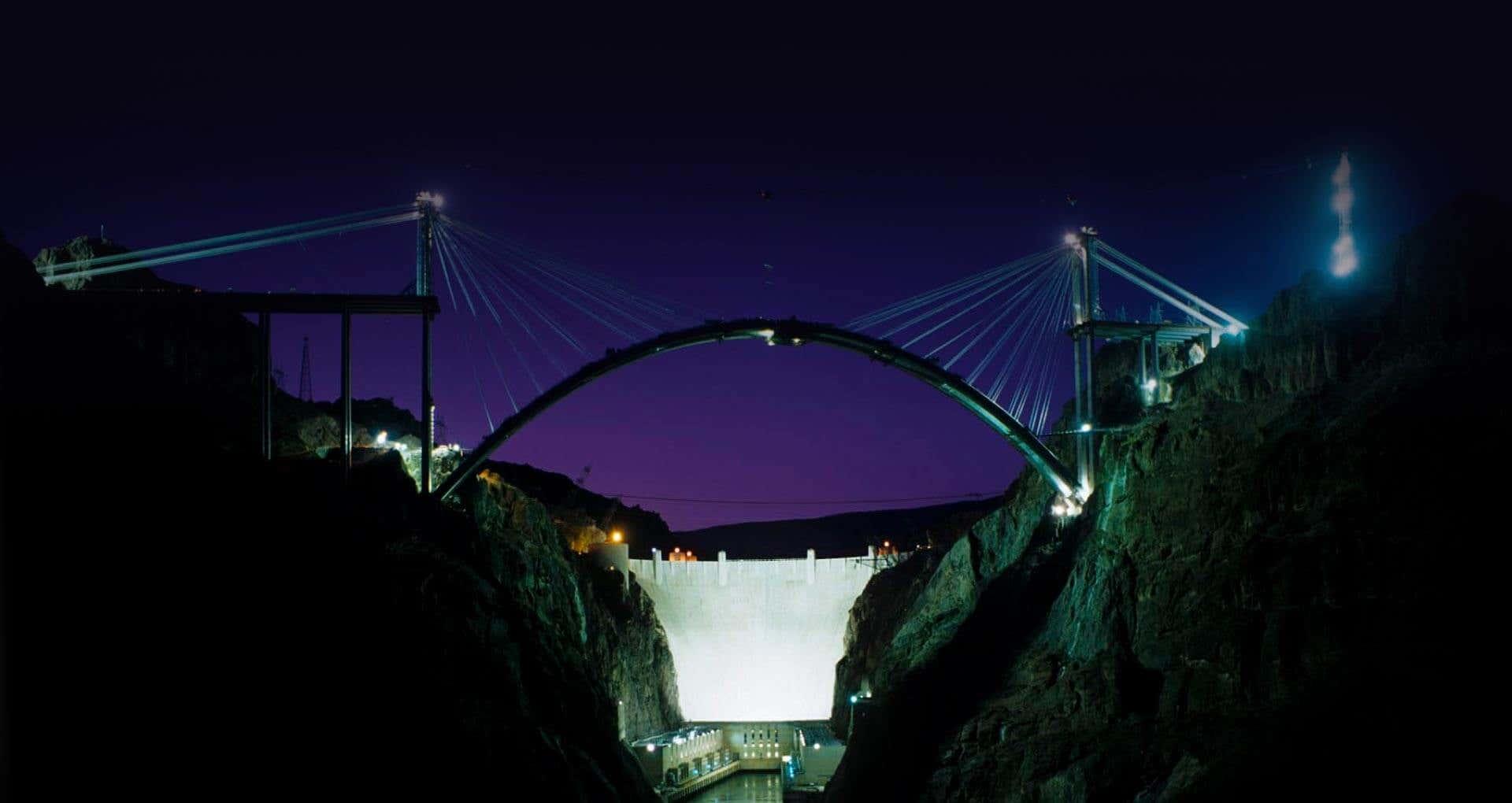 Bridge structure over a water dam