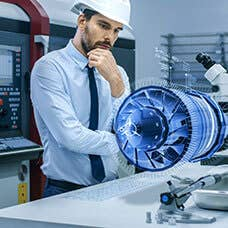 Engineer fascinated with scientific object